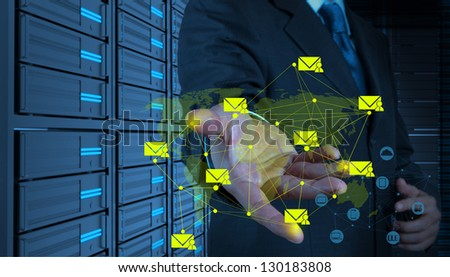 Businessman working with the new computer interface sending email as network concept