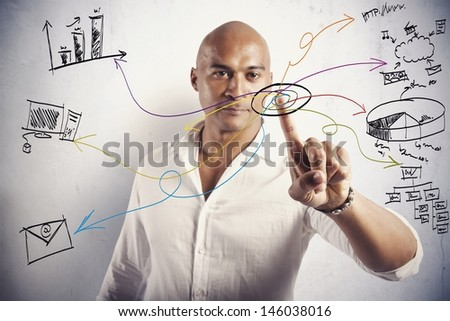 Businessman working with touch screen and moder business symbol