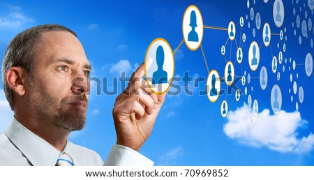 Businessman works with Future Social Network Display