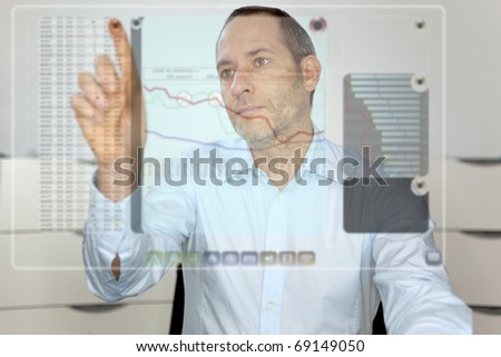 Businessman works with futureistic computer display