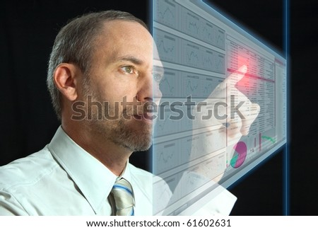 Businessman works with huge LCD panel