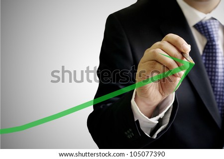 Businessman write a grow up green arrow