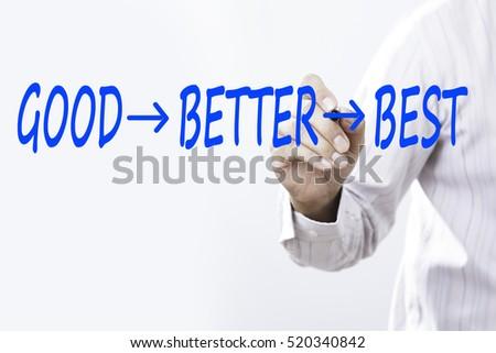 """Businessman writing a motivational concept """"GOOD BETTER BEST"""" #520340842"""