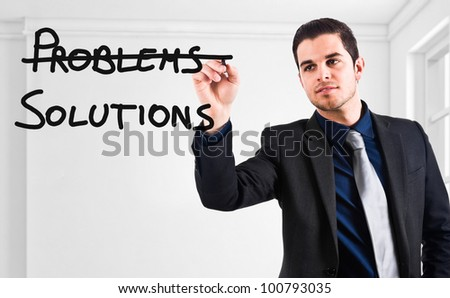 Businessman writing a positive concept on the screen