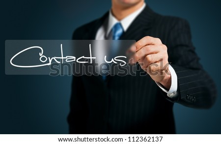 businessman writing contact us  on a  screen