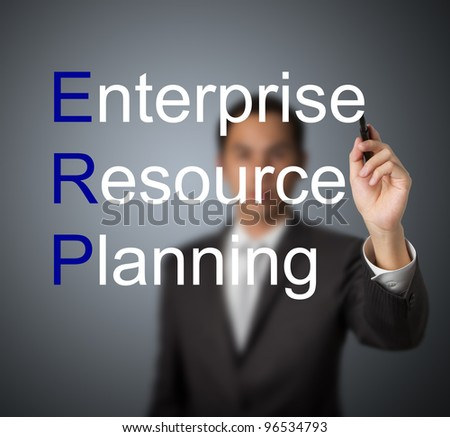 businessman writing enterprise resource planning (ERP) system concept for supply material management business