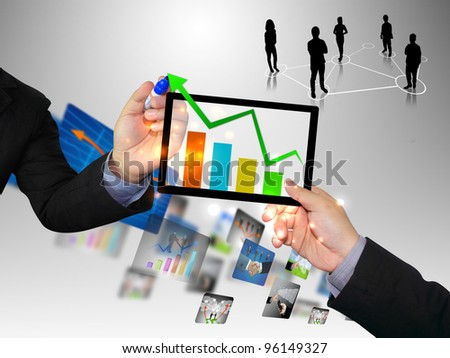 Businessman writing graph