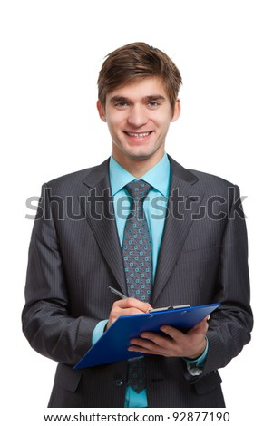 businessman writing on clipboard, handsome young business man happy smile, wear elegant suit and tie isolated over white background