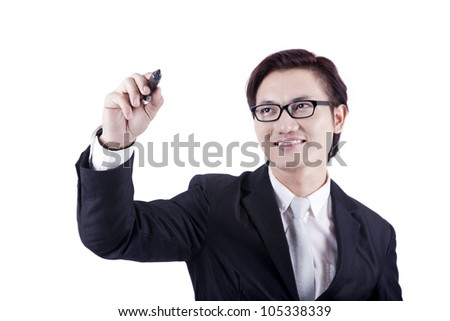 Businessman writing or drawing with pen on copy space, shot in studio isolated on white