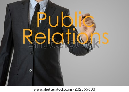 businessman writing public relations concept