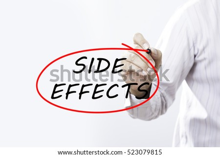 """Businessman writing """"SIDE EFFECTS"""" with marker on transparent board.  Medical concept #523079815"""