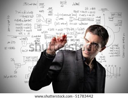 Businessman writing some statistics
