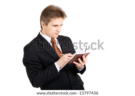 businessman writing something in his notebook