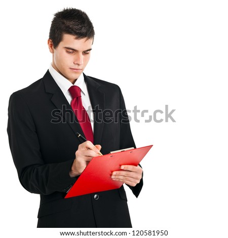 Businessman writing something on a clipboard
