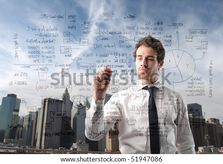 Businessman writing statistics with cityscape on the background