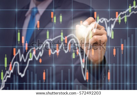 Businessman writing the trading graph of stock market on the virtual screen on dark background, Business stock market concept #572492203