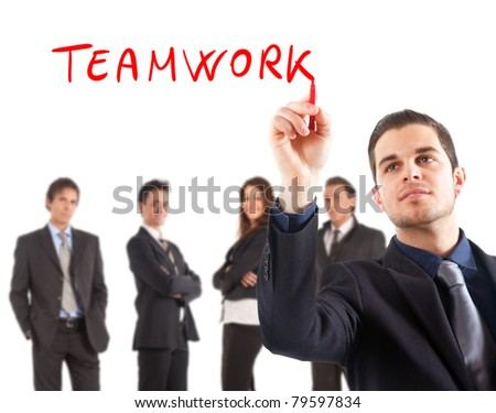 "Businessman writing the word ""teamwork"" on the screen"