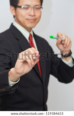 Businessman writing with whiteboard. - stock photo