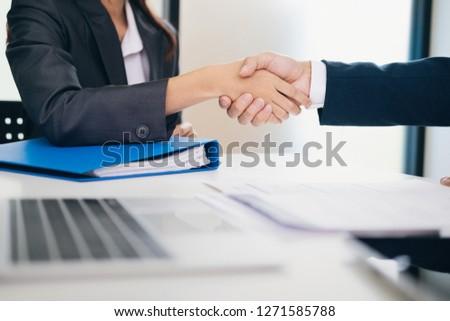 Businessmans handshake. Successful businessmen handshaking after good deal. Business partnership meeting concept. #1271585788