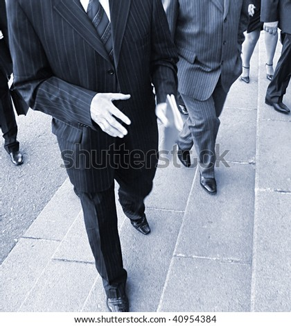 Businessmans went up  stairs. businessmens on their way to the office