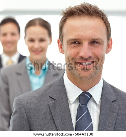 Businessmen and businessman posing together in a row in the office