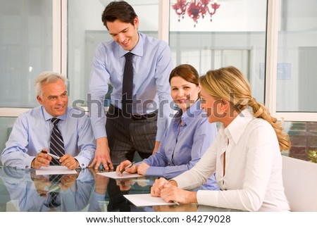 businessmen and businesswomen during a working meeting
