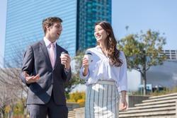 Businessmen and businesswomen having a conversation