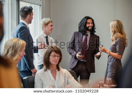 Businessmen and women meeting and greeting each other at a business meeting. #1102049228