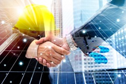 Businessmen are shaking hands for business venture and Marketing on energy. Solar is needed in the future.Solar panels require expertise in installation, photovoltaics to the business sector