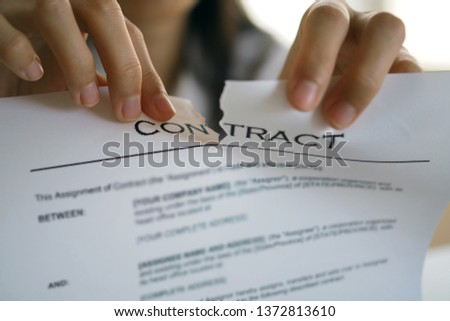 Businessmen are tearing documents, contracts or agreements that have direct legal consequences. Cancel the contract and justice  #1372813610