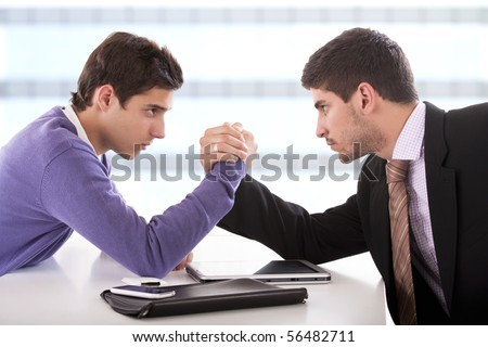 businessmen arm-wrestling.