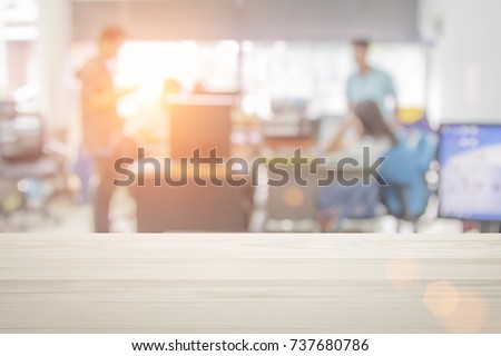 Businessmen blur in the workplace or work space of table in office room with computer or shallow depth of focus of abstract background. stock photo