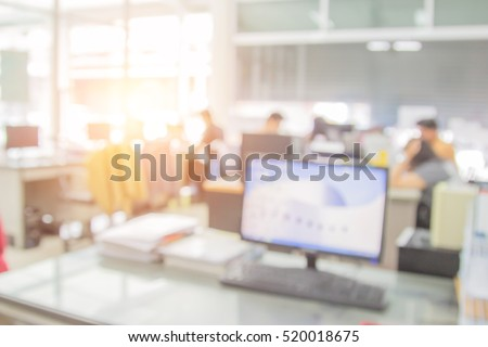 Businessmen blur in the workplace or work space of table work in office with computer or shallow depth of focus of abstract background. stock photo