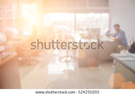 Businessmen blur in the workplace.Table Top And Blur Office of Background.abstract blur background table work in office with computer.Abstract background of office, shallow depth of focus  silhouette.