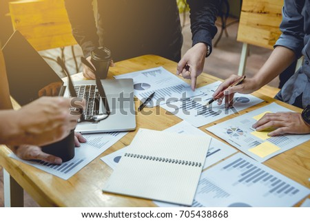 Businessmen debating and discuss work plans at busy time. #705438868