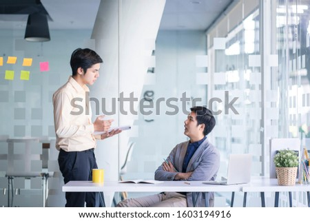 Businessmen discuss information or brainstorm metting in a business working space.