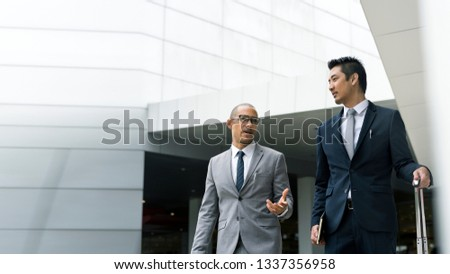 Businessmen discussing on the go #1337356958