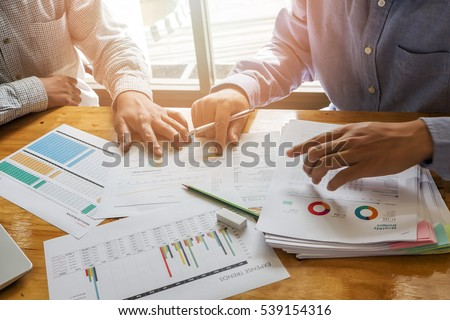 businessmen discussing together in meeting room