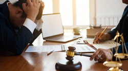 Businessmen feel stressed and desperate after being sentenced to bankruptcy. The concept of bankruptcy action.
