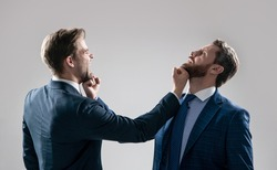 businessmen fighting and punching. boss and employee have conflict. disagreed men partners. business competition. knockout. struggle for leadership. displeased colleague dispute. negotiations.