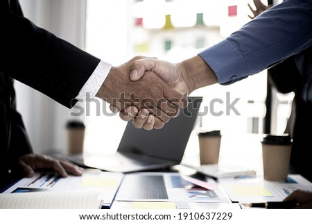 Businessmen Handshaking join to form a startup, Handshaking is a Western greeting or congratulation. Young businessmen form startups and are growing higher. Startup idea.