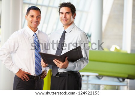 Businessmen Having Informal Meeting In Modern Office