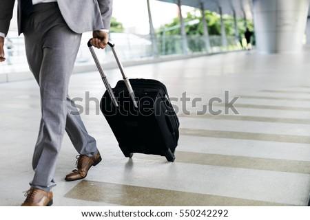 businessmen hold luggage...