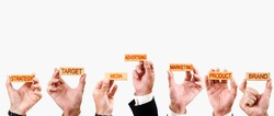businessmen hold wooden blocks with the inscriptions Advertising, Media, product, brand, strategy and target
