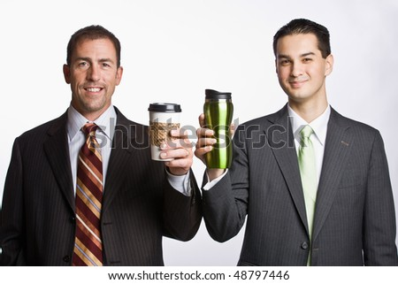 Businessmen holding coffee cups