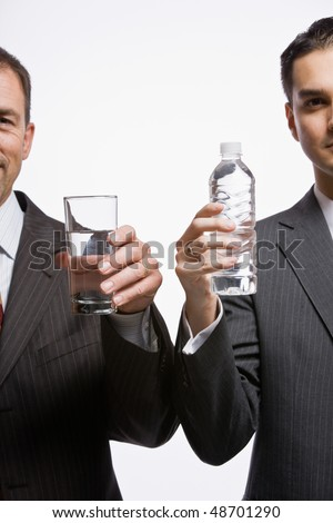 Businessmen holding water