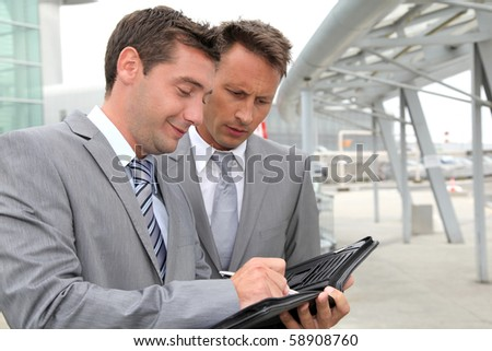 Businessmen in a business meeting away from the office