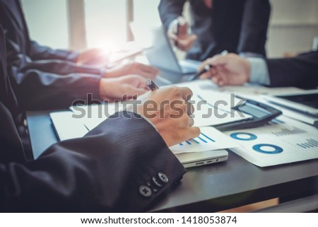 Businessmen in the meeting room are introducing and consulting each other in order to make good business profits. Concepts for advice and consultation between investors to exchange knowledge