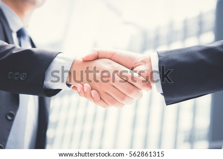 Businessmen making handshake - greeting, dealing, merger and acquisition concepts #562861315