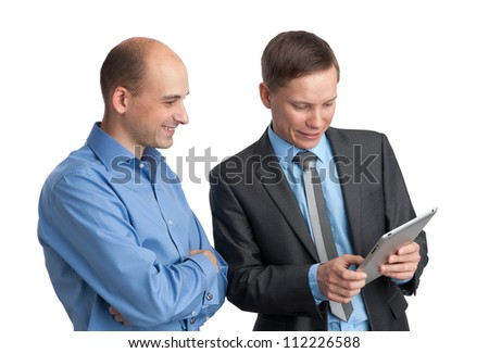 Businessmen meeting and looking at tablet computer. Isolated on white